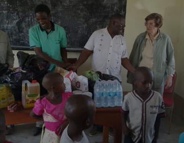 Volunteers giving donation